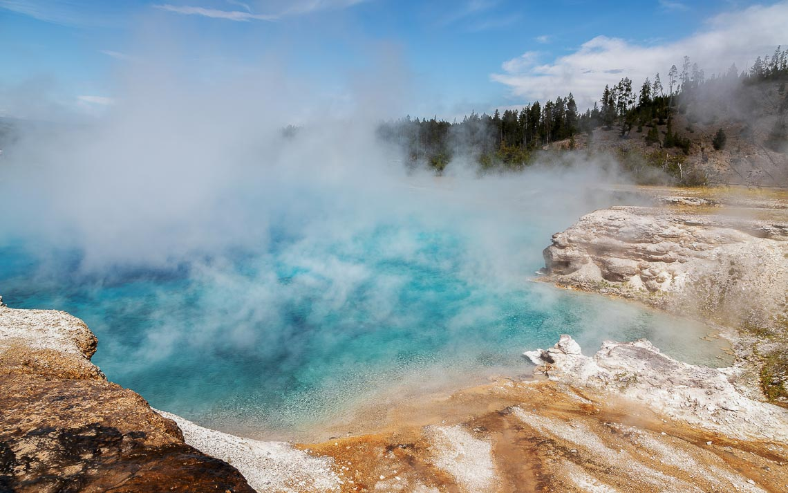 Steam Rises From A Pool At Grand Prismatic Spring In Yellowstone